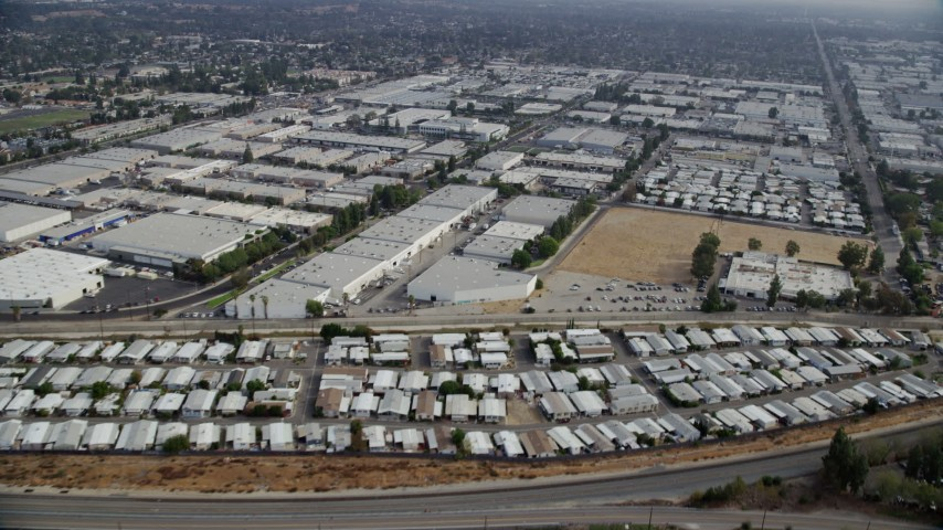 8K stock footage aerial video of mobile homes and warehouse buildings in Chatsworth, California Aerial Stock Footage AX0157_056 | Axiom Images