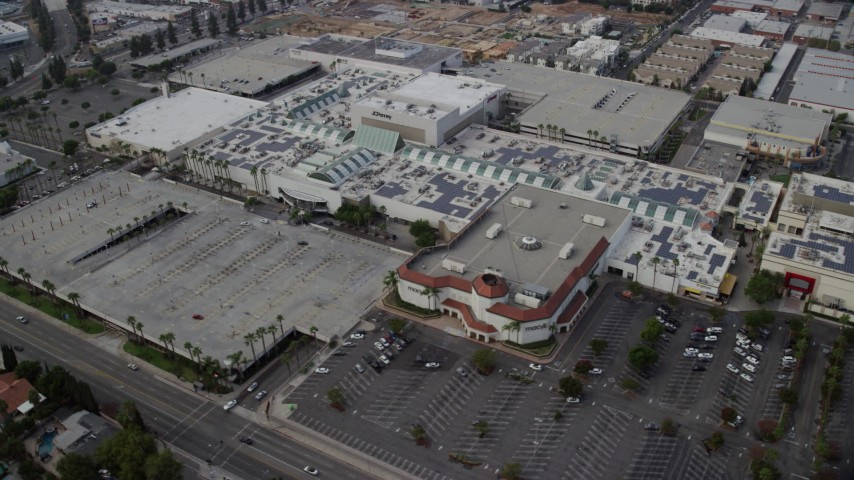 8K stock footage aerial video orbiting Macy's and Northridge Shopping Mall in Northridge, California Aerial Stock Footage | AX0157_059