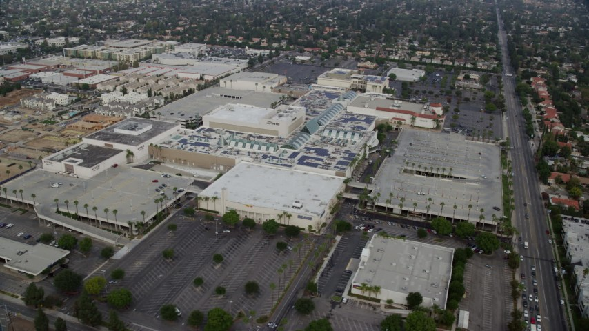 8K stock footage aerial video of Northridge Shopping Mall with empty parking lots in Northridge, California Aerial Stock Footage | AX0157_060