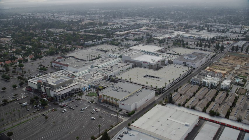 8K stock footage aerial video of Northridge Shopping Mall with few parked cars in Northridge, California Aerial Stock Footage | AX0157_062