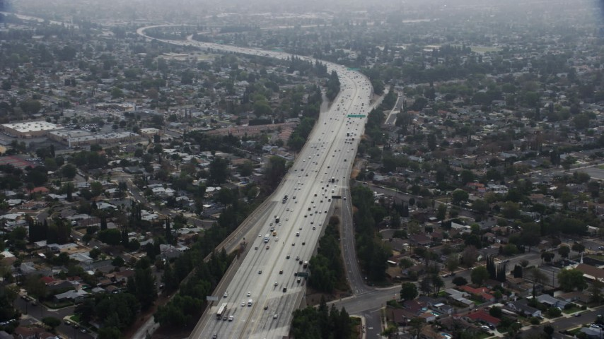 8K stock footage aerial video of light traffic on the 118 Freeway in Granada Hills, California Aerial Stock Footage | AX0157_074