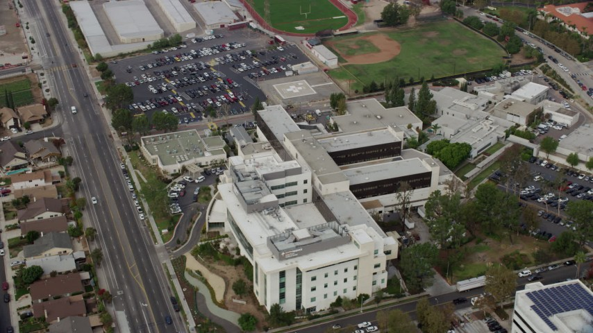 8K stock footage aerial video orbiting Providence Holy Cross Medical Center in Mission Hills, California Aerial Stock Footage | AX0157_076