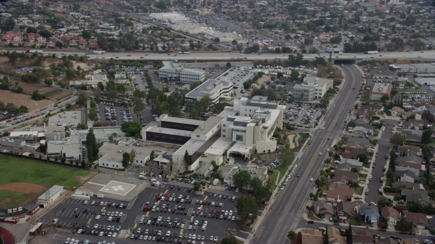 8K stock footage aerial video of a view of Providence Holy Cross Medical Center in Mission Hills, California Aerial Stock Footage | AX0157_078