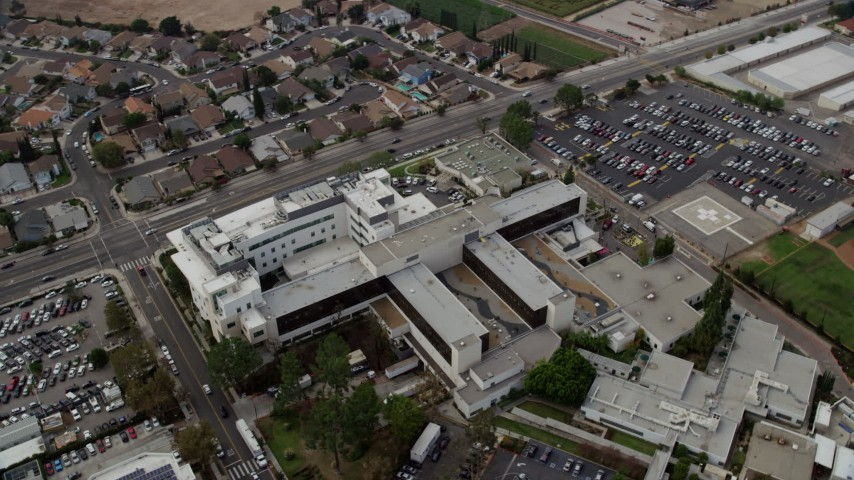 8K stock footage aerial video orbiting Providence Holy Cross Medical Center in Mission Hills, California Aerial Stock Footage | AX0157_080