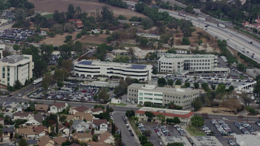 8K stock footage aerial video of Providence Holy Cross Medical Center, Mission Hills, California Aerial Stock Footage | AX0157_084