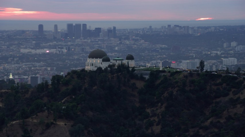 8K stock footage aerial video of Griffith Observatory at twilight against the hills, California Aerial Stock Footage | AX0158_006