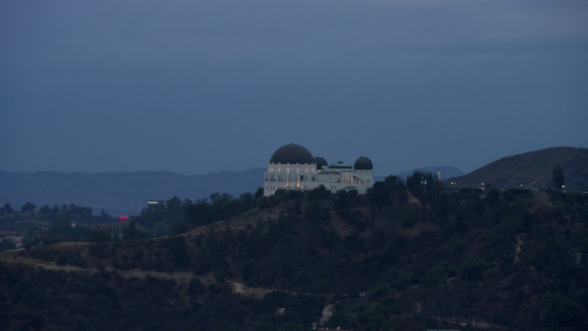 8K stock footage aerial video tracking the Griffith Observatory, twilight, Los Angeles, California Aerial Stock Footage | AX0158_007