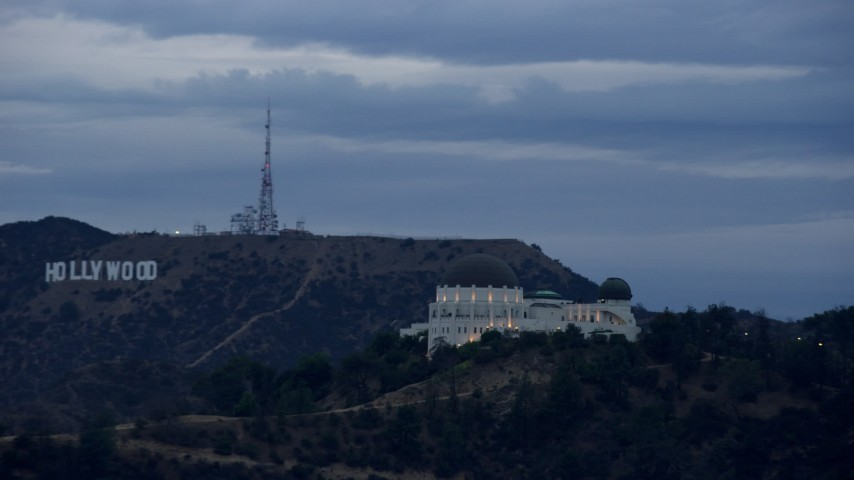 8K stock footage aerial video tracking Griffith Observatory and reveal Hollywood Sign, twilight, Los Angeles, California Aerial Stock Footage | AX0158_008
