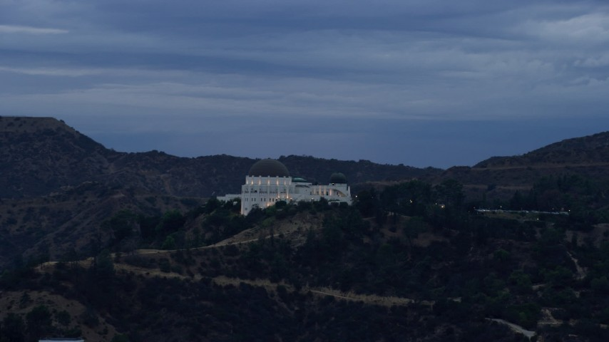 8K stock footage aerial video orbiting the front of the Griffith Observatory, twilight, Los Angeles, California Aerial Stock Footage | AX0158_009