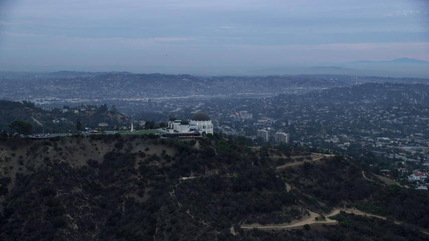8K stock footage aerial video orbiting around the back of the Griffith Observatory at twilight; Los Angeles, California Aerial Stock Footage | AX0158_012