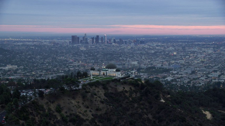 8K stock footage aerial video of Griffith Observatory revealing downtown Los Angeles and city sprawl, twilight, California Aerial Stock Footage | AX0158_013