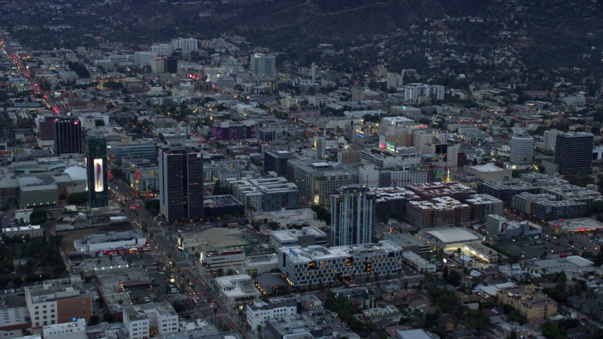 8K stock footage aerial video businesses along Sunset Boulevard at twilight, Hollywood, California Aerial Stock Footage | AX0158_016