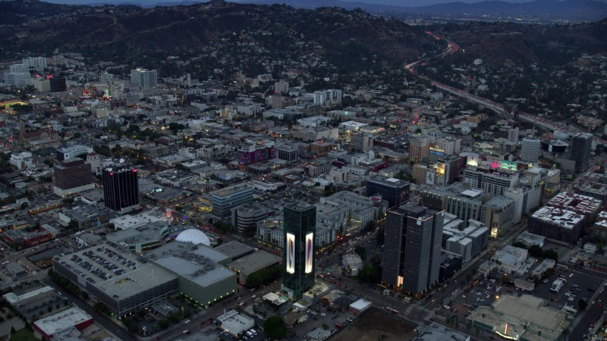 8K aerial video of businesses and office buildings along Sunset Boulevard at twilight, Hollywood, California Aerial Stock Footage | AX0158_017