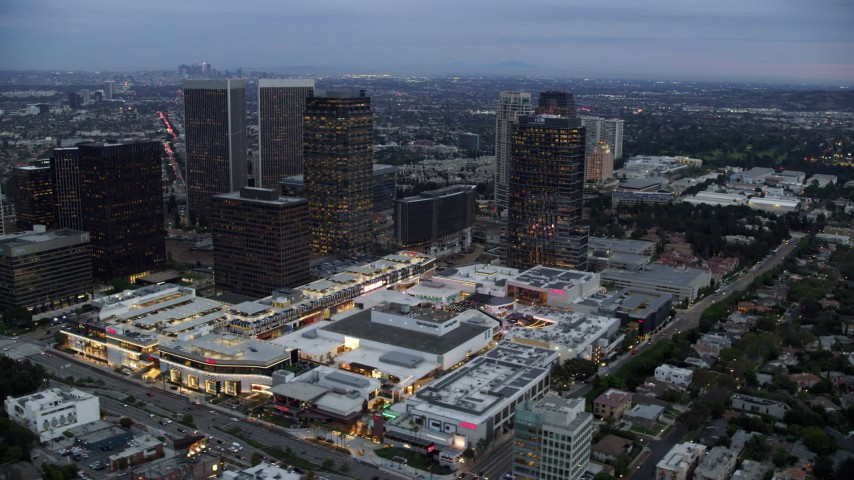 8K stock footage aerial video passing by office buildings and shopping mall, twilight, Century City, California Aerial Stock Footage | AX0158_025