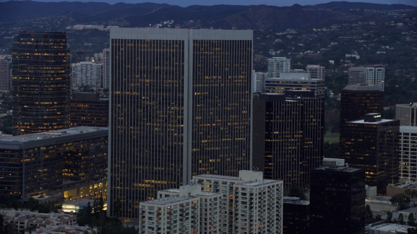 8K stock footage aerial video passing by Century Plaza Towers, twilight, Century City, California Aerial Stock Footage | AX0158_028