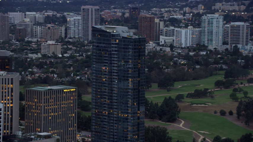 8K stock footage aerial video orbiting new condominium, Ten Thousand, twilight, Century City, California Aerial Stock Footage | AX0158_029