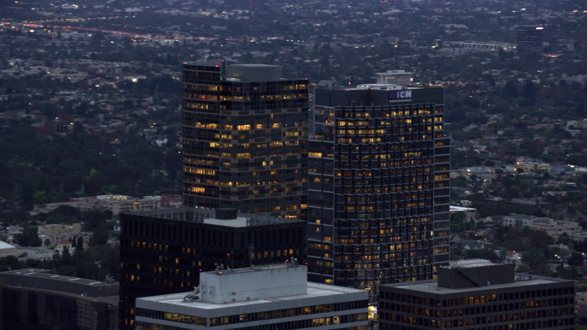 8K stock footage aerial video passing by office buildings, twilight, Century City, California Aerial Stock Footage | AX0158_031