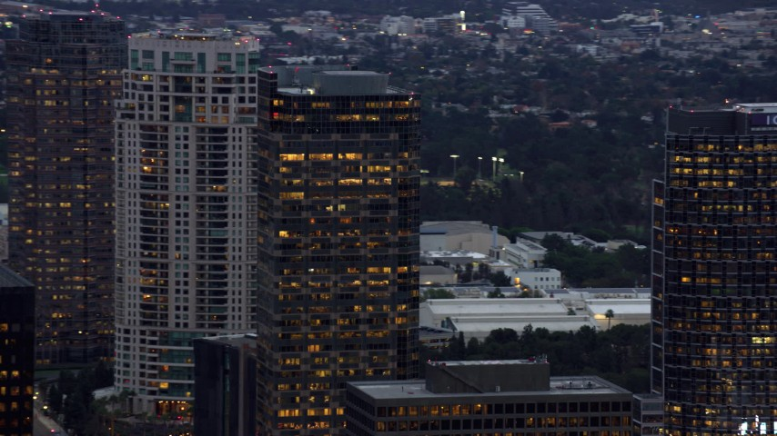 8K stock footage aerial video orbiting office and apartment buildings, twilight, Century City, California Aerial Stock Footage | AX0158_032