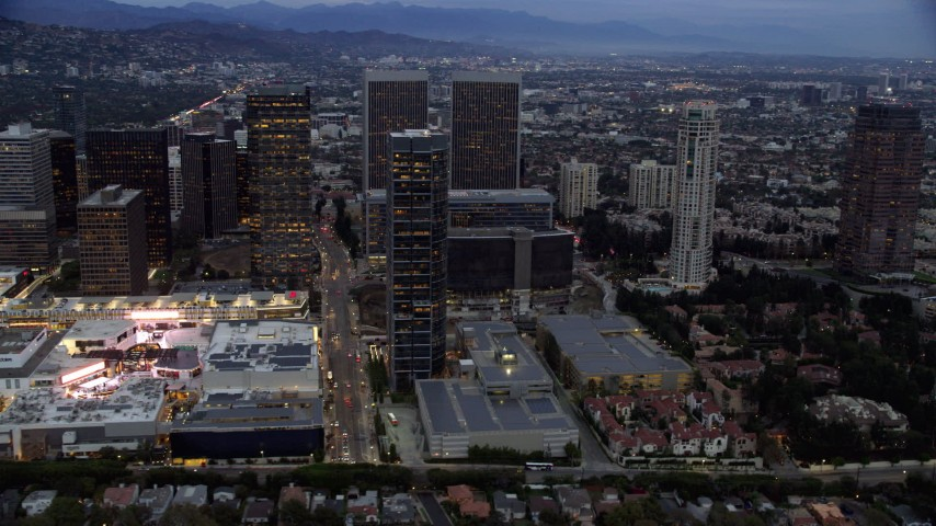 8K stock footage aerial video of Westfield shopping mall, Constellation Place and The Century Plaza Hotel at twilight, Century City, California Aerial Stock Footage | AX0158_034