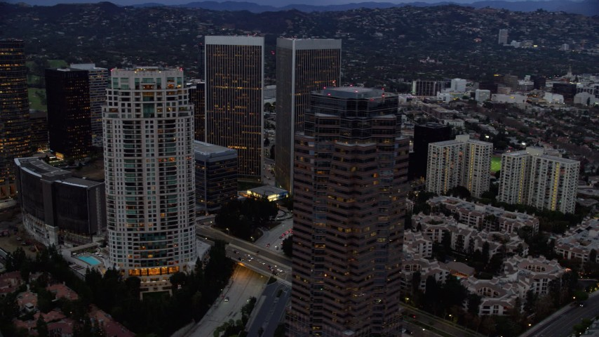 8K stock footage aerial video orbiting office buildings and skyscrapers at twilight, Century City, California Aerial Stock Footage | AX0158_035