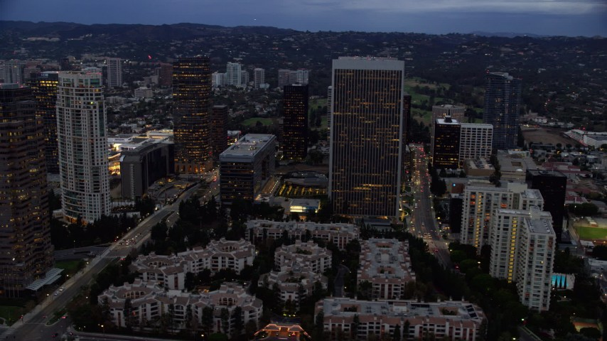 8K stock footage aerial video orbiting away from skyscrapers and condominiums, twilight, Century City, California Aerial Stock Footage | AX0158_036