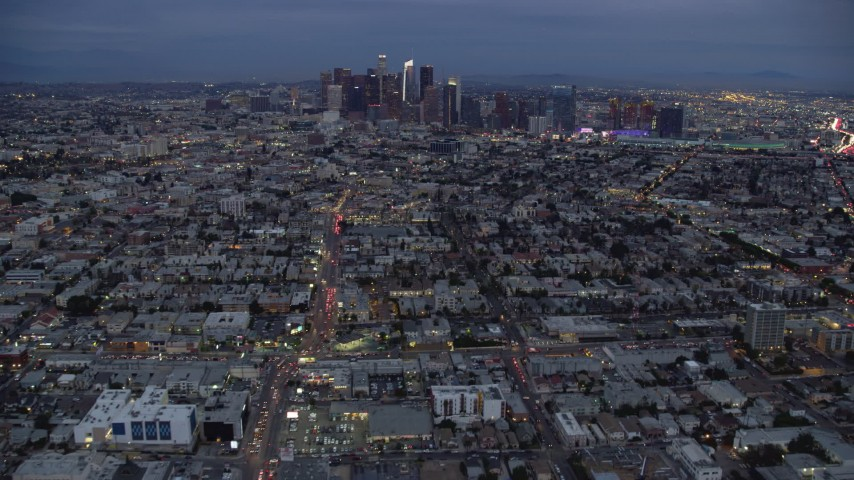 8K stock footage aerial video of Downtown Los Angeles skyline from urban neighborhoods, California, twilight Aerial Stock Footage | AX0158_043