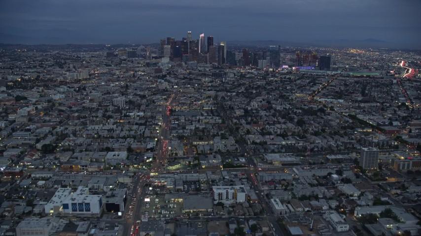 8K aerial video of Downtown Los Angeles skyline from urban neighborhoods, California, twilight Aerial Stock Footage | AX0158_043