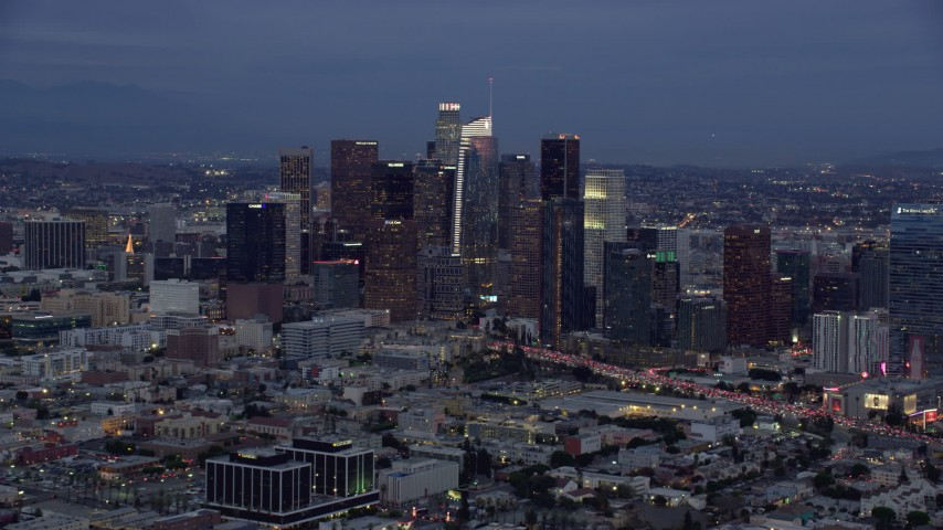 8K stock footage aerial video of Downtown Los Angeles skyline with new skyscraper, Wilshire Grand Center, twilight, California Aerial Stock Footage | AX0158_044