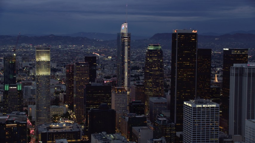 8K stock footage aerial video of Wilshire Grand Center and nearby skyscrapers at twilight in Downtown Los Angeles, California Aerial Stock Footage | AX0158_047