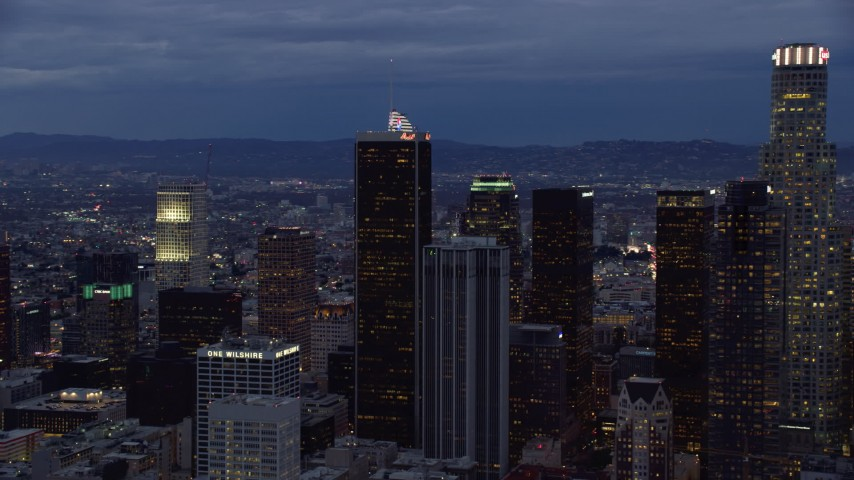8K stock footage aerial video circling a group of skyscrapers at twilight in Downtown Los Angeles, California Aerial Stock Footage | AX0158_048