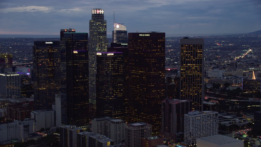 8K stock footage aerial video of a group of skyscrapers at twilight in Downtown Los Angeles, California Aerial Stock Footage | AX0158_049