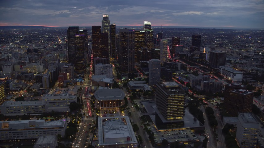 8K stock footage aerial video of skyscrapers, Dorothy Chandler Pavilion, and 110 at twilight in Downtown Los Angeles, California Aerial Stock Footage | AX0158_050