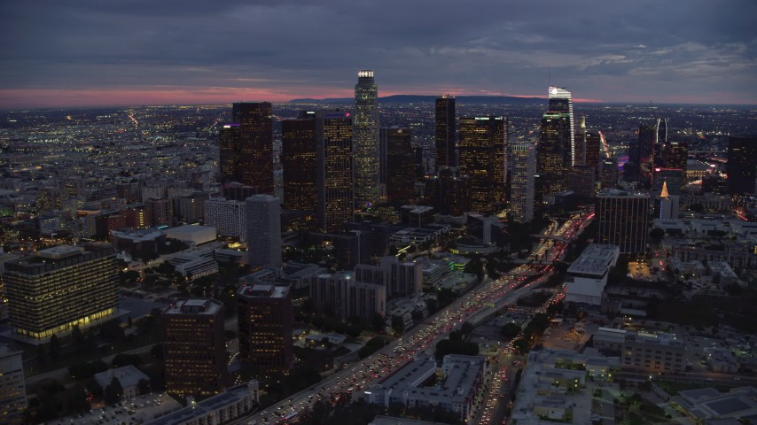8K stock footage aerial video of tall skyscrapers at twilight in Downtown Los Angeles, California Aerial Stock Footage | AX0158_051
