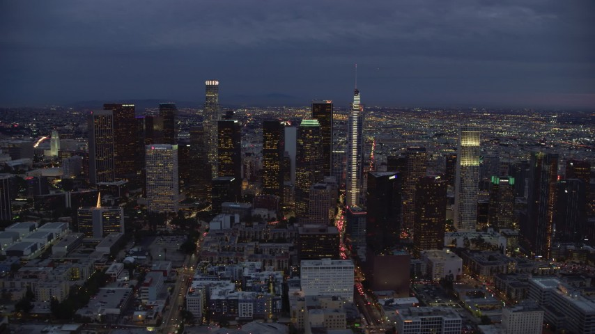 8K aerial video flying by skyscrapers at twilight in Downtown Los Angeles, California Aerial Stock Footage | AX0158_053