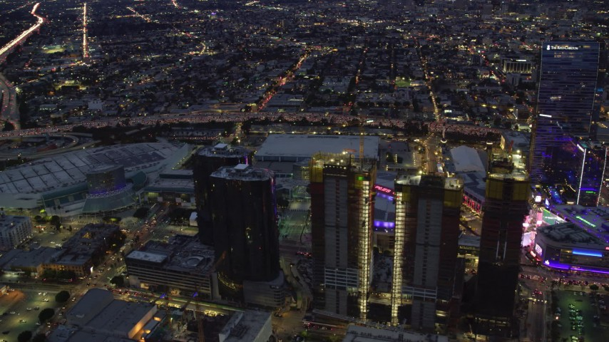 8K stock footage aerial video orbiting Oceanwide Plaza to reveal Staples Center at twilight in Downtown Los Angeles, California Aerial Stock Footage | AX0158_060
