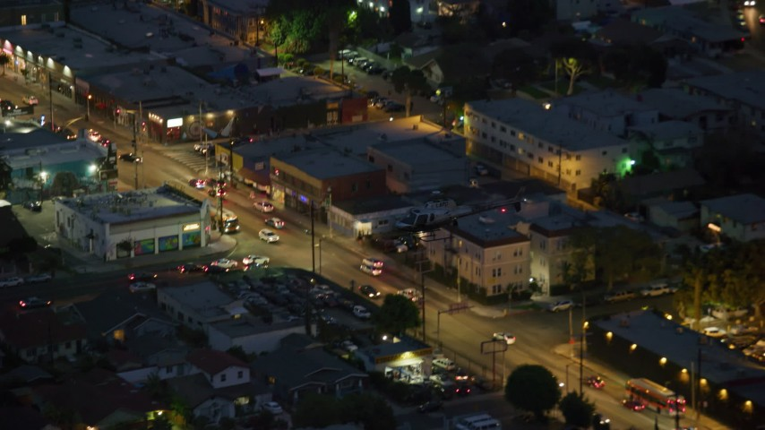 8K stock footage aerial video tracking LAPD helicopter at twilight in Hollywood, California Aerial Stock Footage | AX0158_071