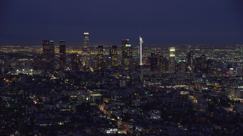 8K stock footage aerial video of a slow approach to the tall towers of Downtown Los Angeles, California at night Aerial Stock Footage | AX0158_072