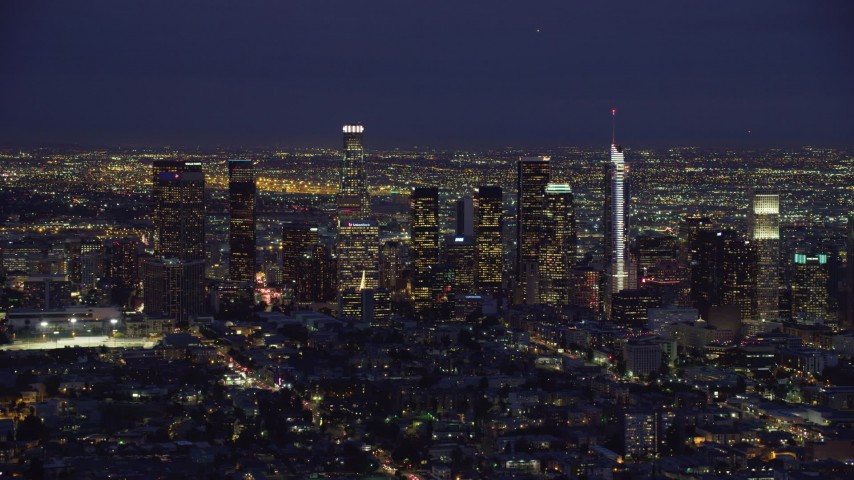 8K stock footage aerial video approaching the Downtown Los Angeles skyline at night, California Aerial Stock Footage AX0158_073
