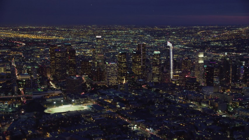 8K stock footage aerial video approaching skyscrapers lit up for the night in Downtown Los Angeles, California Aerial Stock Footage | AX0158_074
