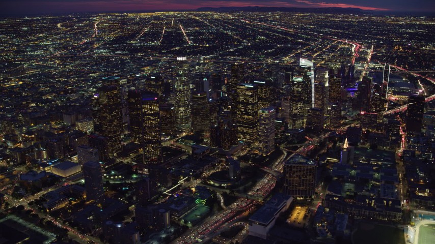 8K stock footage aerial video of Downtown Los Angeles skyscrapers at nighttime in California Aerial Stock Footage | AX0158_076