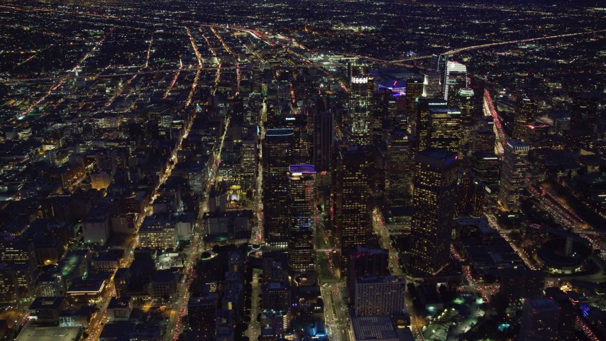 8K stock footage aerial video passing by skyscrapers in downtown at night, Downtown Los Angeles, California Aerial Stock Footage | AX0158_077