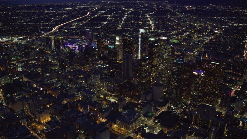 8K stock footage aerial video of the lights and skyscrapers of Downtown Los Angeles, California at night Aerial Stock Footage | AX0158_078