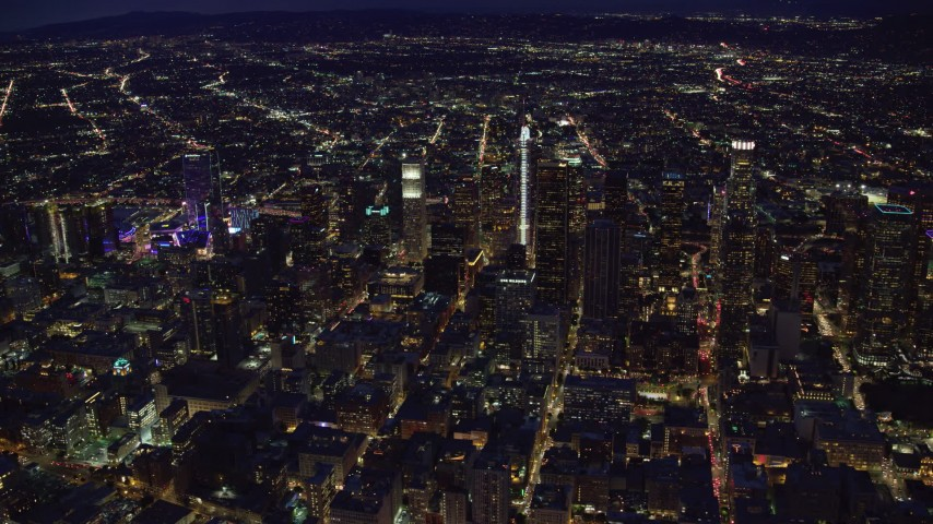 8K stock footage aerial video of Downtown Los Angeles, California lit up at nighttime Aerial Stock Footage | AX0158_079