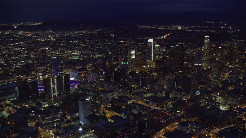 8K stock footage aerial video flying by Downtown Los Angeles, California at nighttime Aerial Stock Footage | AX0158_081