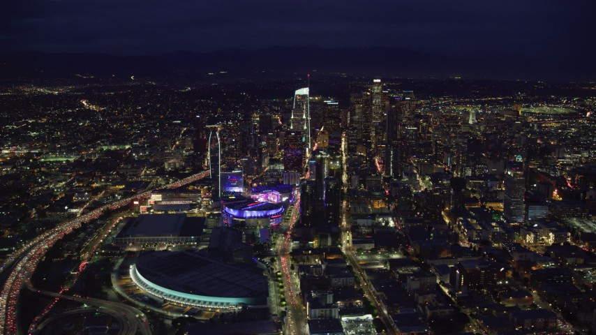 8K aerial video of the convention center, Staples Center, and skyscrapers at night, Downtown Los Angeles, California Aerial Stock Footage AX0158_083
