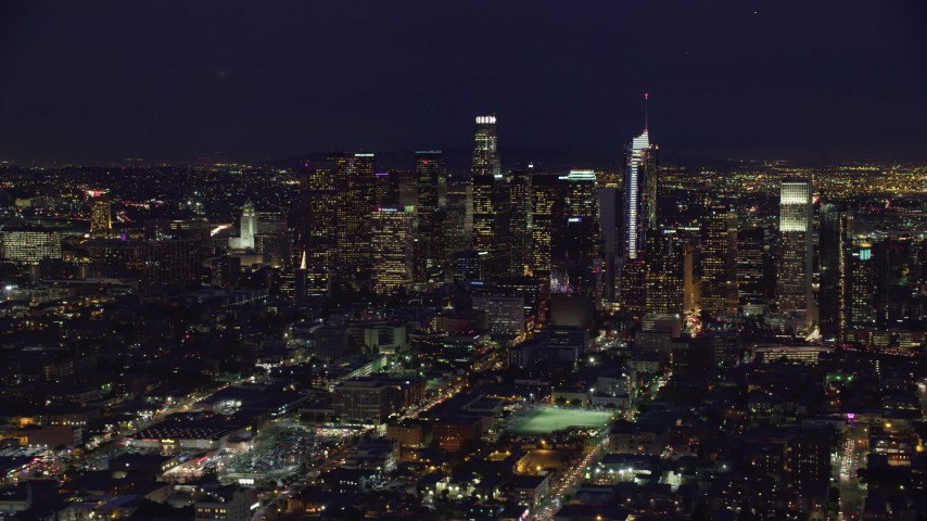 8K stock footage aerial video passing skyscrapers at night in Downtown Los Angeles, California Aerial Stock Footage | AX0158_085