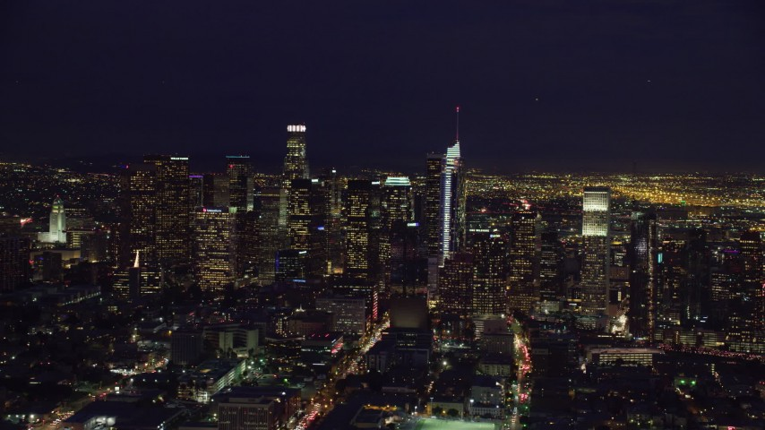 8K stock footage aerial video flying by skyscrapers at nighttime in Downtown Los Angeles, California Aerial Stock Footage | AX0158_088