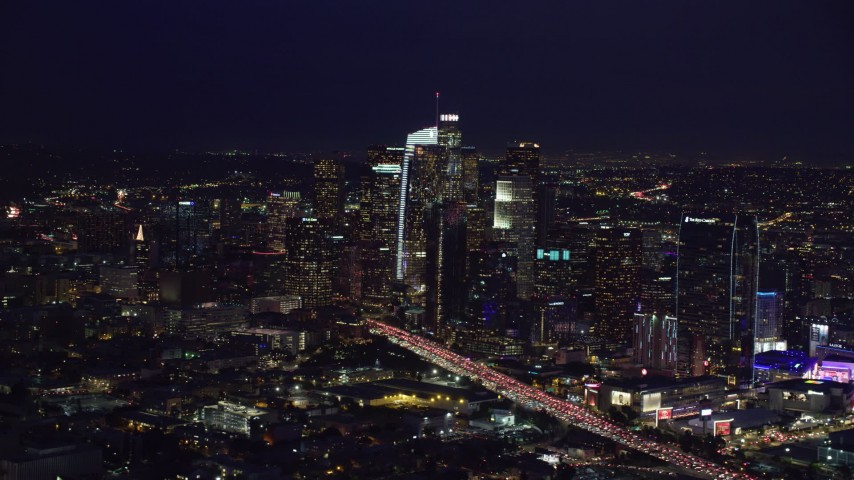 8K stock footage aerial video of skyscrapers and heavy traffic on the 110 at night in Downtown Los Angeles, California Aerial Stock Footage | AX0158_090
