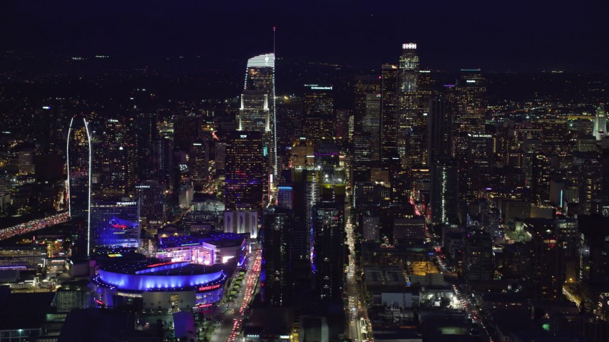 8K stock footage aerial video of Staples Center and skyscrapers at night in Downtown Los Angeles, California Aerial Stock Footage | AX0158_092