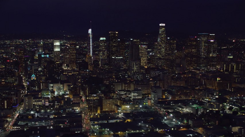 8K stock footage aerial video of skyscrapers at night in Downtown Los Angeles, California, seen from south of downtown Aerial Stock Footage | AX0158_094